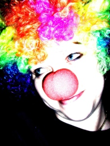 fun and happy clown with clown wig